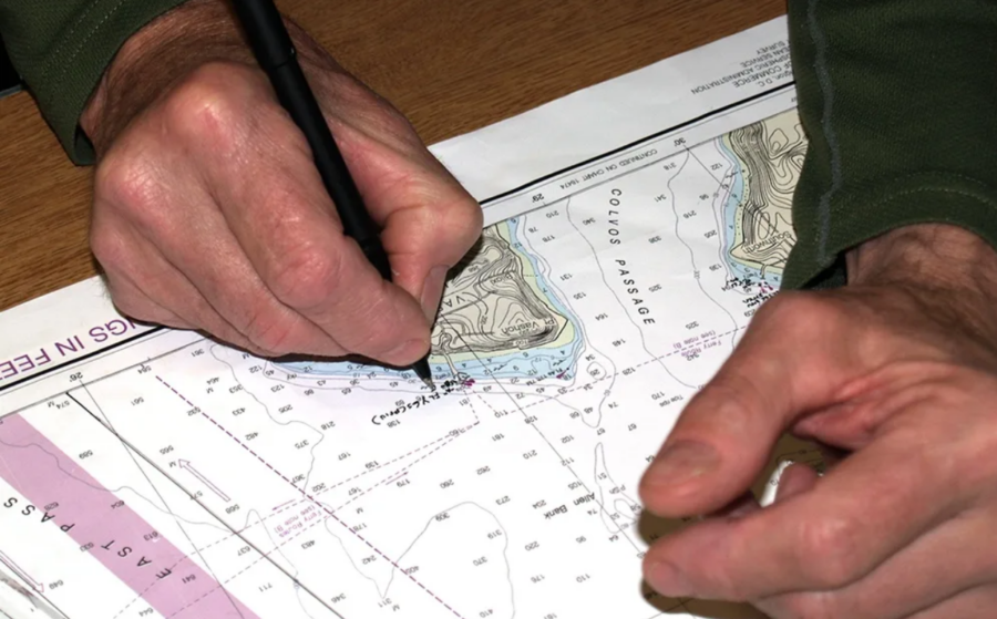 Someone examining a hydrographic chart