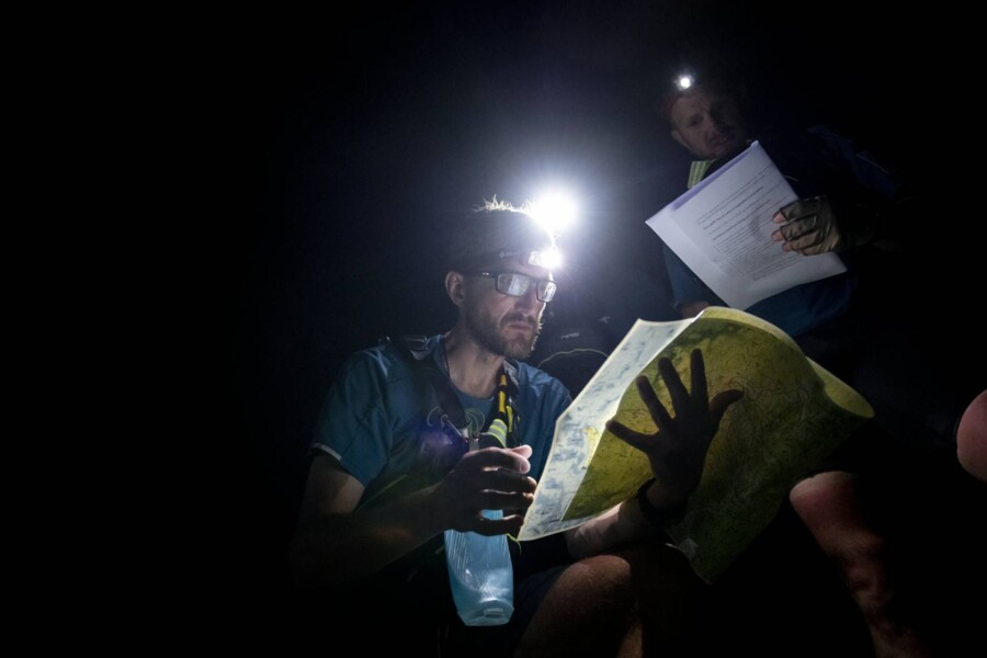 A racer on Eco-Challenge: World's Toughest Race reading an East View Geospatial topographic map